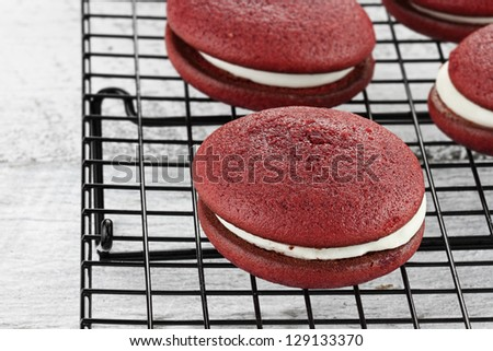 Red velvet whoopie pies or moon pies. Shallow depth of field. - stock photo