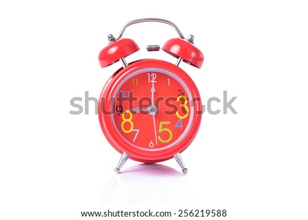 Red vintage alarm clock isolated on white - stock photo