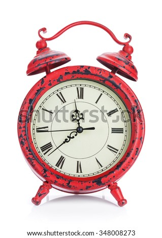 Red vintage alarm clock. Isolated on white background