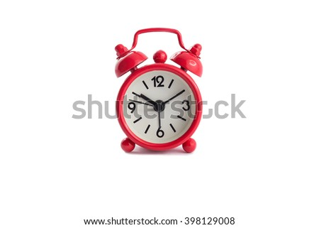 Red vintage alarm clock isolated on white background