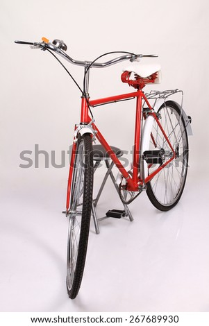 red vintage bicycle - stock photo