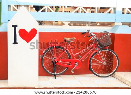 """Red vintage bicycle with """" I Love """" paint - stock photo"""