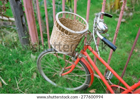 red vintage bicycle with selective focus effect - stock photo