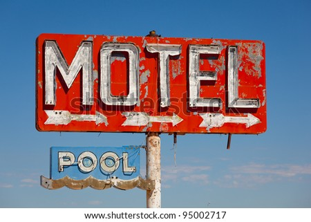 Red, vintage, neon motel sign on blue sky - stock photo