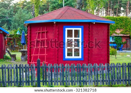 Red vintage outhouse. Lithuania. - stock photo