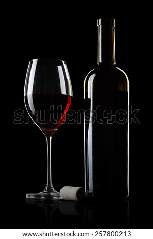 red vintage wine photographed on a dark background