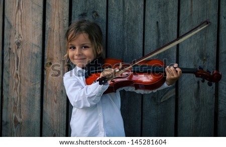 red violin and boy - stock photo
