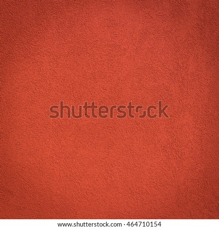 Red wall background and texture with vignetting and blank copyspace for text or advertising.