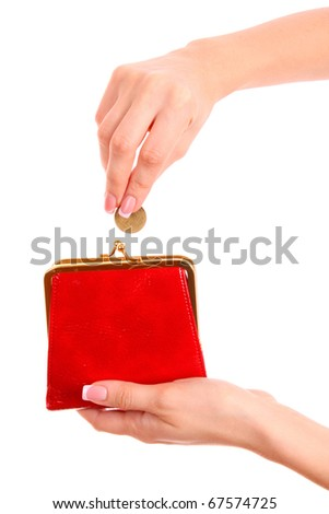 Red wallet and coin in woman hand over white background - stock photo