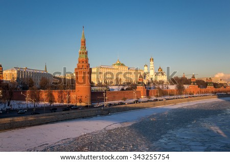 Red walls of sunset Kremlin in Moscow near iced river  in winter - stock photo