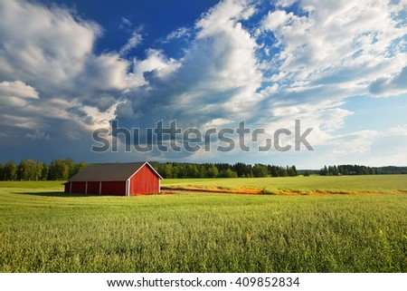 Red warehouse in Finland in the countryside - stock photo