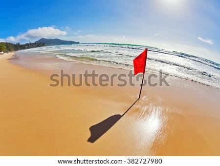 Red warning flag at beach. Phuket, Thailand.  - stock photo