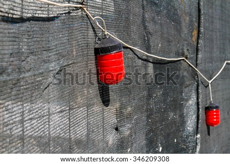 Red warning lights on the fence - stock photo