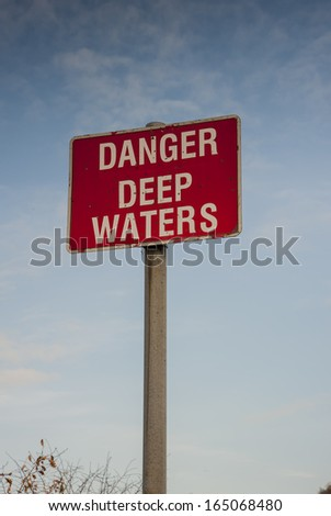 red warning sign for deep waters - stock photo