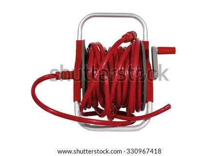 red watering garden hose on the spool isolated on white background. - stock photo