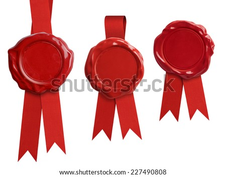 Red wax seal stamps with ribbon isolated on white - stock photo