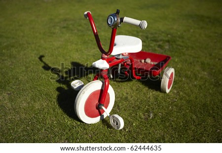 red 3 wheel bike - stock photo