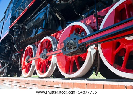 red wheels of steam train - stock photo