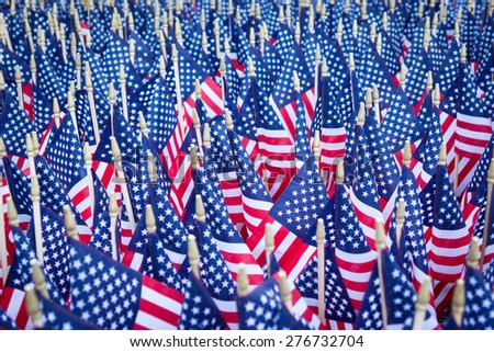 Red white and blue American flags grouped together in a massive patriotic memorial. - stock photo