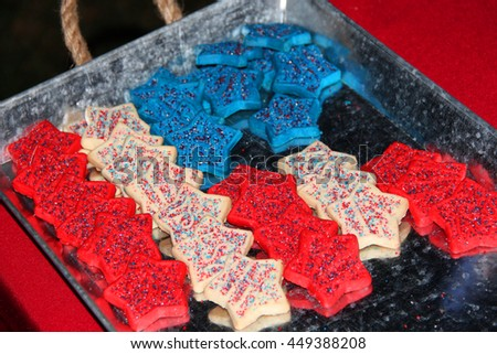 Red, white and blue cookies shaped as an American flag - stock photo