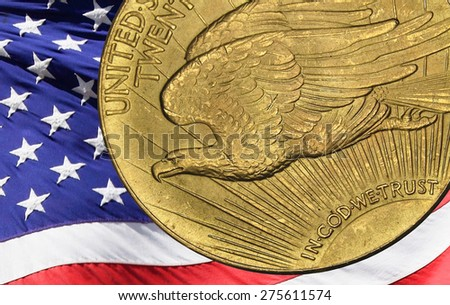 Red, white, and blue from american flag reflected in God We Trust Motto on vintage 1924 Double Eagle, Saint Gaudens' design. - stock photo