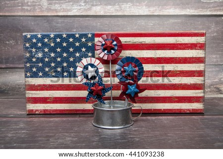 Red, white, and blue pinwheels in front of the American flag