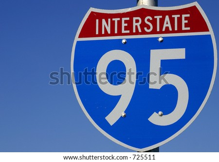Red, white and blue sign directing travelers toward Interstate 95 in Central Florida, USA