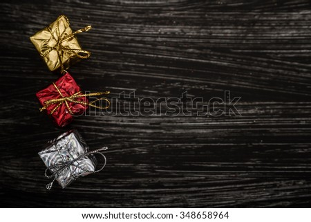 Red, white and golden Christmas toys and decorations on dark background with copy space - stock photo