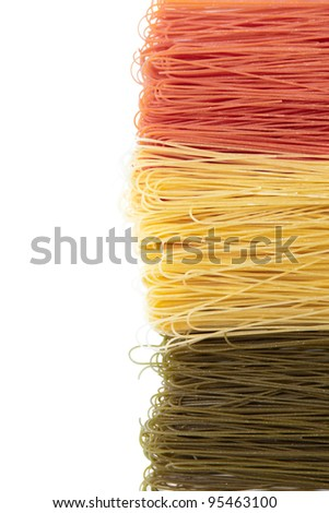 Red, white and green dried spaghetti in Italian flag colors isolated on white