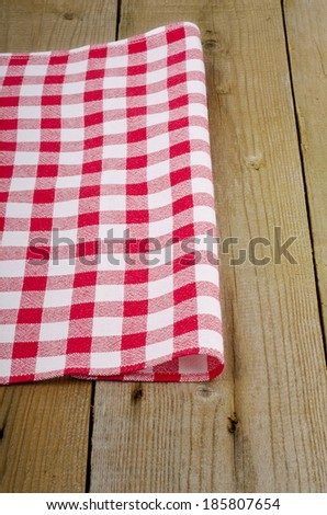 red-white checkered tablecloth in an old wooden table