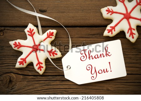 Red White Christmas Star Cookies with Thank You Label, Christmas or Winter Background - stock photo