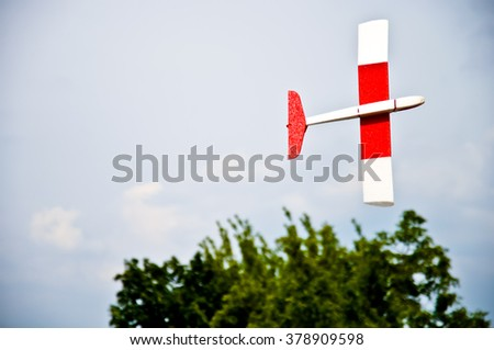 Red-white flying toy glider  - stock photo