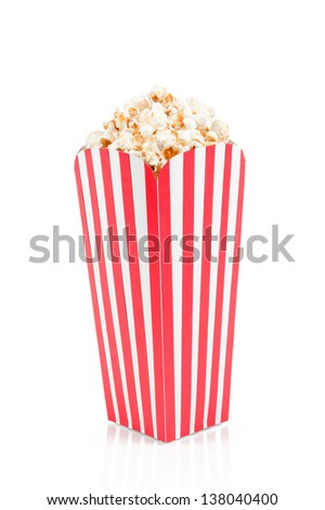 Red white striped popcorn box isolated - stock photo