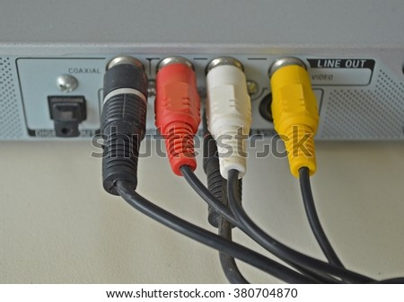 red white yellow AV cable plugged in electronic devices  - stock photo