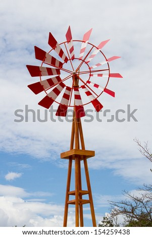 Red windmills in the farm - stock photo