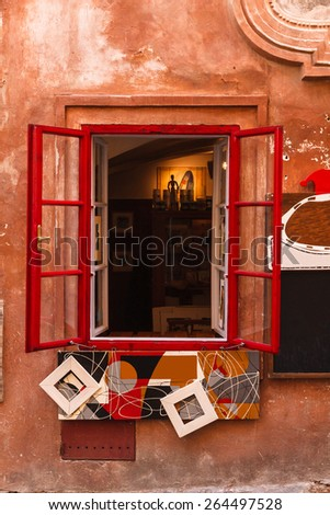 Red window frame in old town of Cesky Krumlov, Czech Republic