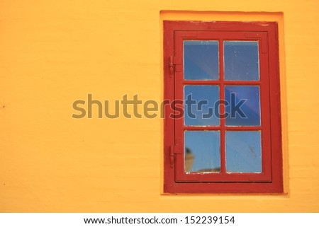 red window on orange wall background house facade architecture detail, scandinavia