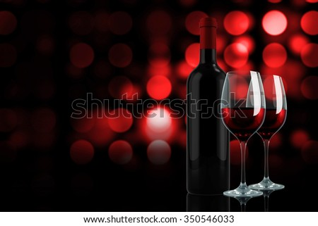 Red wine against colourful circles on black background