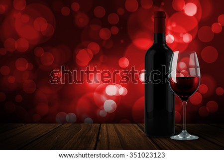 Red wine against digitally generated twinkling light design