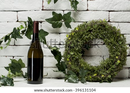 red wine and a bottle isolated over white stone backgroun with clipping path. - stock photo