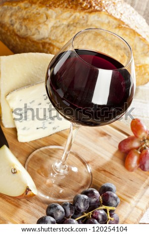 Red Wine And Assorted Cheese Plate with fruit - stock photo