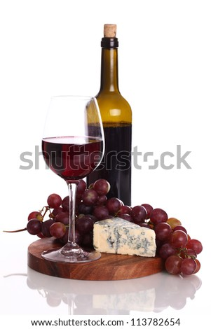 Red wine and blue cheese over white background - stock photo