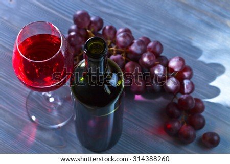 red wine and grape on old blue table
