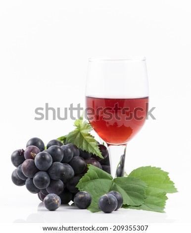 Red wine and grapes isolated on white