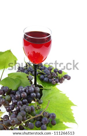 Red wine and grapes on white background