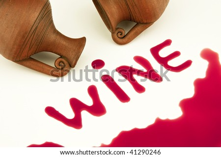 red wine and pitcher on a white background - stock photo
