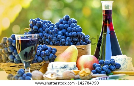 Red wine and red grapes - stock photo