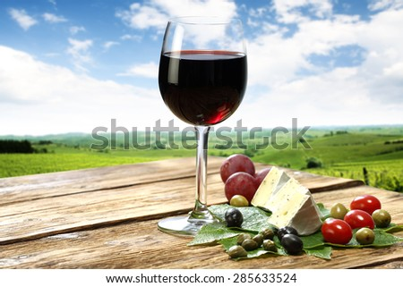red wine and wooden old table place