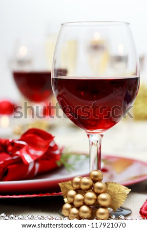 Red wine at Christmas dinner - stock photo