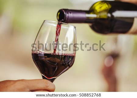 Red Wine Being Poured In The Glass